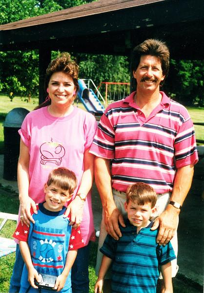 "Back row: Penny Lea (Habben) Ordean (1959 -  ), David Timothy Ordean (1955 - )<br /> Front row: Chad David Ordean (1990 - ), Shane Elliot Ordean (1992 - )<br /> Written in the Rogers Reunion Photo Album Volume III page 99 ""Penny, David, Chad & Shane"""