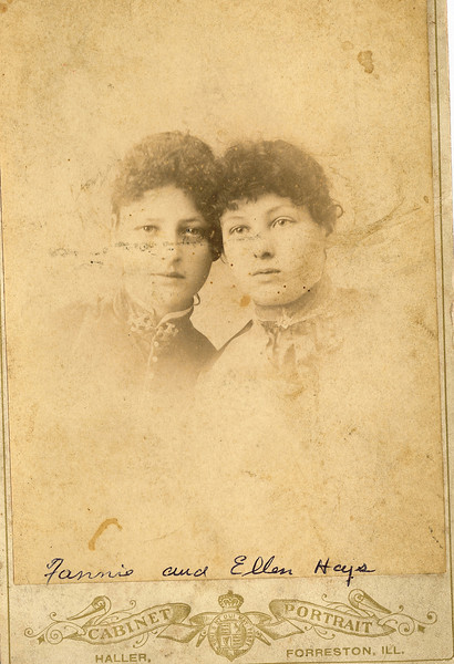 "Fannie Belle Hays (1871-1919), Martha Ellen Hays (1869-1959) Written in the Rogers Reunion Photo Album Volume III page  18 on and under the photo ""Fannie and Ellen Hays Sisters"". On the back of the photo next to Ellen's name ""Mrs Woolsey""."
