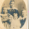 "1) Perry Winfield Dew (1891-1975), 2) Byron Elmer Dew (1893-1986), 3) Mary Lavinna Dew (1895-1992), 4) Josie Louisa Dew (1897-1999) Written in the Rogers Reunion Photo Album Volume III page 65 ""Perry in back the oldest #1, Elmer on the right – next oldest #2, Mary on the left – the oldest girl #3, Josie front center – next born #4.  The four oldest children of Wm & Fannie Dew.  1899 photo. Perry age 8, B. Elmer age 6, Mary L. age 4, Joise L. age 2"""