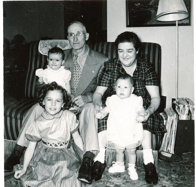 """Front row: Cheryl Ann Yount (1945-1983), Gary Allan Dew (1956-)  Back row: Carol Sue Yount  (1952-), Byron Elmer Dew (1893-1986), Mabelle Elizabeth (Coursey) Dew (1896-1961)  Written in the Rogers Reunion Photo Album Volume III page 38 """"Elmer & Mabel Dew"""" """"Cheryl & Carol Yount, Gary Dew"""""""
