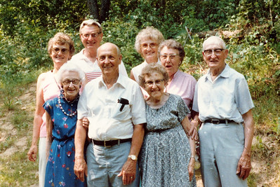 "Front row: Glenna Ellen Dew (1900-1997), Burl Orville Dew (1904-2001), Josie Louisa Dew (1897-1999), Alice Martha Dew (1902-1999), Byron Elmer Dew (1893-1986). Back row: Evelyn Lois Dew (1929-2004), Robert Edwin ""Ed"" Dew (1924-2006), Donna Rogers Dew (1927-2006).  Written in the Rogers Reunion Photo Album Volume III page 26 "" Children of Wm Dew and Fannie Hays Glenna, Burl, Josie, Alice & Elmer. Children of Wm Dew and Jennie Pittman Evelyn, Ed & Donna."""