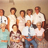"Front row: Mary Lavinna Dew (1895-1992), Josie Louisa Dew (1897-1999), Byron Elmer Dew (1893-1986), Glenna Ellen Dew (1900-1997)   Back row: Orville Dew (1904-2001), Evelyn Lois Dew (1929-2004) Alice Martha Dew (1902-1999), Donna Rogers Dew (1927- 2006), Robert Edwin ""Ed"" Dew (1924-2006) Written in the Rogers Reunion Photo Album Volume III page 22 ""Aug 7, 1983 – Elmer's 90th Birthday. Back: Burl, Evelyn, Alice, Donna & Ed. Front: Mary, Jose, Elmer & Glenna"""