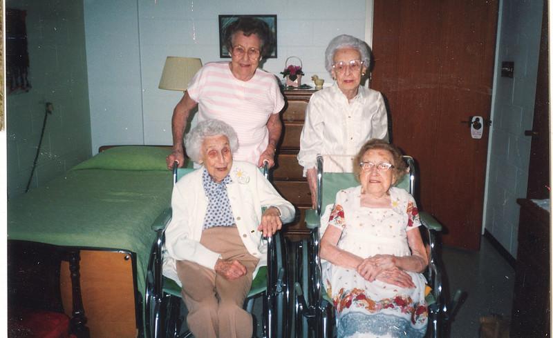 "Front row: Mary Lavinna Dew (1895-1992), Josie Louisa Dew (1897-1999)  Back row: Alice Martha Dew (1902-1999), Glenna Ellen Dew (1900-1997) Written in the Rogers Reunion Photo Album Volume III page 26 ""Alice, Glenna, Mary, Josie""."