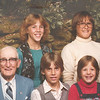 "Front row: Byron Elmer Dew (1893-1986), David Charles Rader (1968 - ), Nyree Dawn Zak (1975- )  Back row: Debra Dee Rader (1967- ), Justin Kent Zak (1969- )Written in the Rogers Reunion Photo Album Volume III page 38 ""Elmer & descendants Great Grandchildren (back row) Debbie Rader, Justin Zak, Elmer, David Rader, Nyree Zak (1956)"""