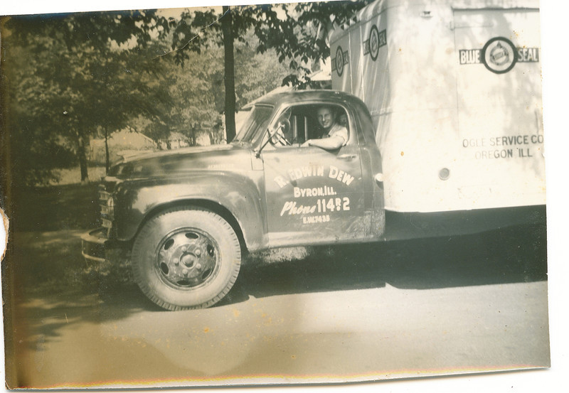 "Robert Edwin Dew (1924-2006) at the wheel.  On the side of the truck ""R. Edwin Dew, Byron, Ill. Phone 1147r2""  Located in the Rogers Reunion Photo Album Volume III page 118."