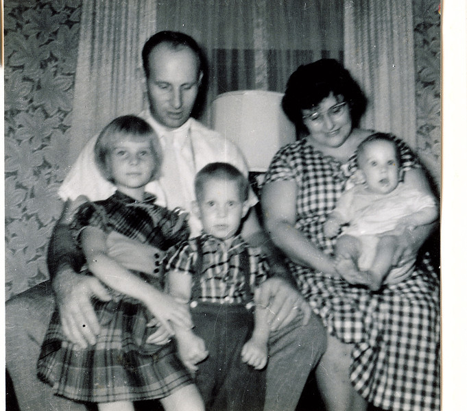"Robert Edwin ""Ed"" Dew (1924-2006), Viola ""Vickie"" Clara (Radke) Dew, Catherine Elizabeth Dew (1955 - ), David William Dew (1959- ), Paul Edwin Dew (1961 - )  Written in the Rogers Reunion Photo Album Volume III page 114 ""about 1960"""