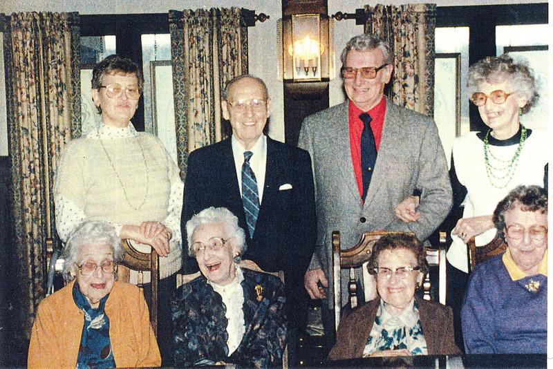 "Front row: Mary Lavinna Dew (1895-1992), Glenna Ellen Dew (1900-1997), Josie Louisa Dew (1897-1999), Alice Martha Dew (1902-1999).  Back row: Evelyn ""Evie"" Lois Dew (1929-2004), Burl Orville Dew (1904-2001), Robert Edwin ""Ed"" Dew (1924-2006), Donna Rogers Dew (1927-2006 ) Written in the Rogers Reunion Photo Album Volume III page 24 under each person in the front row ""Mary, Glenna, Josie, Alice"". Over each person in the back row ""Evie, Burl, Ed, Donna"""