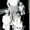 "Evelyn Lois (Dew) Gruben (1929-2004) with children Diane Marie Gruben born 1957 standing next to stroller, Ellen Kay Gruben born 1958, baby Jennifer Ann Gruben born 1959 and Donald Edward Gruben born 1955 standing behind stroller.  Written in the Rogers Reunion Photo Album Volume III page 172 ""Diane, Evie, Ellie, Jen (baby), Don"""