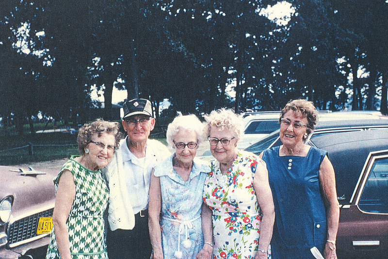 "Josie Louisa Dew (1897-1999), Byron Elmer Dew (1893-1986), Glenna Ellen Dew (1900-1997), Mary Lavinna Dew (1895-1992), Alice Martha Dew (1902-1999)  Written in the Rogers Reunion Photo Album Volume III page 24 ""Glenna (center) 1975 with brother and sisters Josie, Elmer, Glenna, Mary, Alice"""