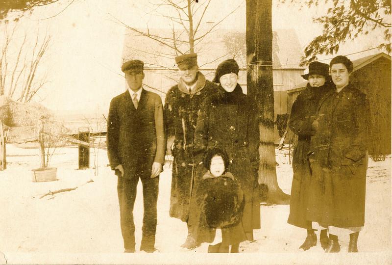 """Byron Elmer Dew (1893-1986), William Alfred Dew (1869-1965), Glenna Ellen Dew (1900-1997), Josie Louisa Dew (1897-1999),  Mabelle Elizabeth (Coursey) Dew (1896-1961), Margaret Louise Dew (1916-2003) Written in the Rogers Reunion Photo Album Volume III page 35 """"Elmer, Wm., Glenna, Josie, Mabelle, and (little girl) Margaret"""