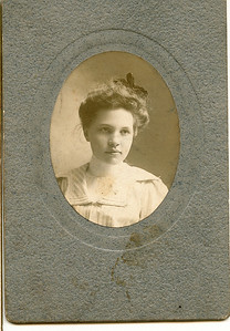 "Grace Milicent Burrows (1881 - 1904) daughter of Loren Gilbert and Henrietta (Shaffner) Burrows. Written in the Rogers Reunion Photo Album Volume II below the photograph ""Grace Burrows - dau of Loren Burrows Age 19 yr 8 mo - 1900 born Forreston, Il. Died age 22.""  On the back of the photograph ""unreadable Grace Milicent Burrows 19 years 8 months old 1900 born at Forreston, Ill Oct 31."""