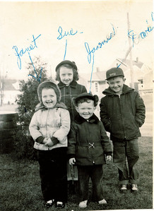 "Front row Janet Lois Frantz (1948 -  ), James Lowell Frantz (1950 - ) Back row Sue Ann Frantz (1944 - ), David Melvin Frantz (1947 - )   Written in the Rogers Reunion Photo Album Volume II page 44 near the photo  ""Melvin Frantz children Nov 24, 1952 Janet age 4, James ag 2 yr 9 mo, David age 6 yr 7 mo, Susan age 8 yr 1 mo. Taken on Janet's 4th birthday.""  Next to the photo in different handwriting ""Sue Ann Frantz b. Oct 12, 1944, David Melvin Frantz b. April 6, 1947, Janet Lois Frantz b. Nov 24, 1948, James Lowell Frantz b. Feb 25, 1950  Wm Dew record"""