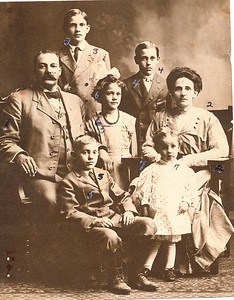 "Front row: Max Albert Conrad (1898-1982), Robert Theodore Conrad (1907-1966) Middle row: Charles Melvin Conrad (1872-1935), Vivian Adeline Conrad (1903-1985), Flora Permilla (Frantz) Conrad (1867-1961) Back row: Frantz Cecil Conrad (1895-1979), Glenn Virgil Conrad (1896-1929) Written in the Rogers Reunion Photo Album Volume II page 45 near the photo  ""Frantz 3, Charles 1, Max 5, Glen (sic) 4, Vivian 6, Flora 2, Robert 7 (in dress)""  The numbers refer to the numbers written on the photograph.  Also on the page ""Flora Permilla Frantz 1867-1961 married Aug 3, 1893 Charles Melvin Conrad 1872-1935 Children: Frantz C. Conrad 1895-1979, Glen (sic) Virgil Conrad 1896-1929, Max Albert Conrad 1898-1982, Vivian Adeline Conrad 1903-1985, Charles Arthur Conrad 1904-1904, Robert Theodore Conrad 1907–1966"""