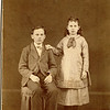"Elwin E. Frantz (February 4, 1865 - September 10, 1892) and his sister Flora Permilla Frantz (August 9, 1867 - 1961) the children of James E. and Lavinna Adelaide (Rogers) Frantz.  Written above the photo in the Rogers Reunion Photo Album Volume 1, page 22 ""Elwin E. and Flora Permilla Frantz""  Written below Elvin ""b 1865"".  Written below Flora ""b 1867"" Written below both ""photo ca 1877-80?""  Caption on this page ""James E. & Lavina Adelia (Rogers) Frantz Family"""