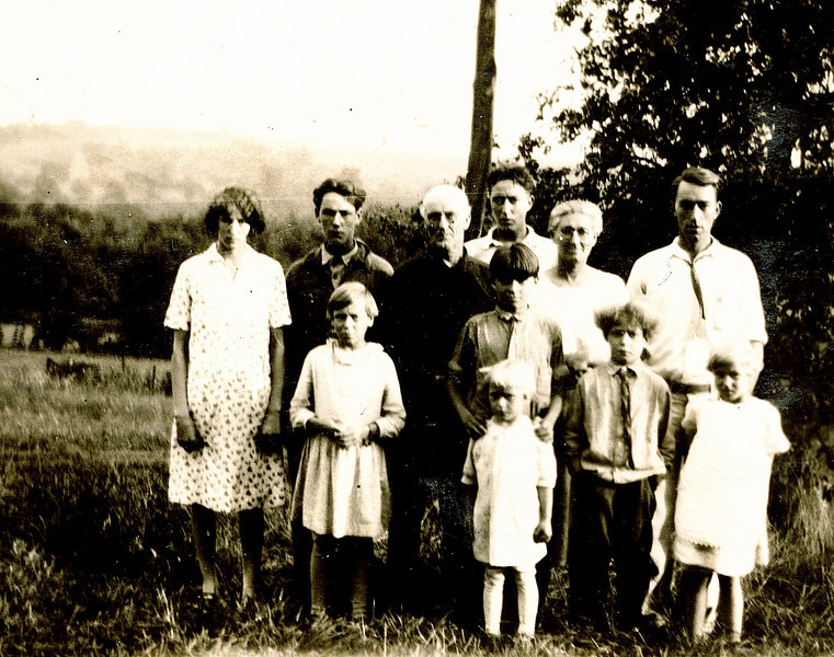 "Written in the Rogers Reunion Photo Album Volume 1, page 21.<br /> ""Back row: Grace, Wayne, Father Harry R. Meredith, Frank, Mother Mable and Paul<br /> Front: L to R: Emma Jean, Glenn, Zella in front of Glenn, Ford and Katheryn.<br /> Zella was born in 1921 and Katheryn in 1924 - Photo 1928""<br /> These are the children of Harry Reasman Meredith (December 18, 1866 - December 1, 1934) and Mabel Elizabeth Case (September 28, 1881 - May 15, 1964).<br /> Back Row L to R:  Grace Laura Meredith (September 5, 1912 - June 30, 1994), Wayne Webster Meredith (October 18, 1913 - May 4, 1939), father Harry Reasman Meredith, Frank Case Meredith (February 5, 1911 - November 30, 1984), mother Mabel Elizabeth Case, Paul Glenn Meredith (August 29, 1907 -  December 15, 1980)<br /> Front L to R: Emma Jean Meredith (June 20, 1918 -  ), Glenn Richard Meredith (January 12, 1917 - February 1, 1995), Zella Elizabeth Meredith (September 10, 1921 - September 14, 1999), Ford Clark Meredith (September 1, 1920 - October 26, 1998), Kathyrn Rae Meredith (March 29, 1924 - )."