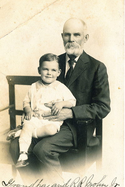 """Russell Rogers Mohn (1916 -        ) sitting on the lap of his grandfather Gilbert Plummer Rogers (1846-1925).  Written on the photo """"Grandpa and R.R. Mohn Jr.).  Russell wasn't really a junior.  He was the son of Russell Reitzel Mohn and Ada Anna Rogers."""