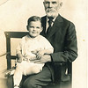 "Russell Rogers Mohn (1916 -        ) sitting on the lap of his grandfather Gilbert Plummer Rogers (1846-1925).  Written on the photo ""Grandpa and R.R. Mohn Jr.).  Russell wasn't really a junior.  He was the son of Russell Reitzel Mohn and Ada Anna Rogers."