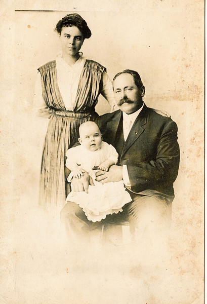 "Ada Anna Rogers (1876-1954) and Russell Reitzel Mohn (1877-1969) and their son Russell Rogers Mohn (1916 - still living in 2011).  ""Baby Russell age 8 mo - 20 lbs photo Feb 1917"" sent as a photo post card to William and Fannie Dew."