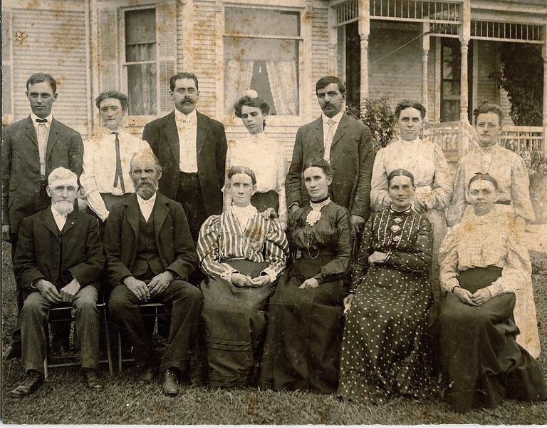 "Joseph and Hannah Rogers' children, grandchildren and spouses. Dated 1905<br /> Taken on the Joseph Rogers farm near Polo, Illinois<br /> Standing L to R: Miles Rogers (1878-1966),Mabelle (Keator) Rogers (1881-1957), Russell Reitzel Mohn (1877-1969), Ada (Rogers) Mohn (1876-1954), Samuel Peter Good (1866-1966), Minnie (Dew) Good (1867-1958), Fannie (Hays) Dew (1871-1919),<br /> Seated L to R: Edwin Dew (1831-1910), Gilbert Plummer Rogers (1846-1925), Percilla (Rogers) Dew (1844-1923), Ruey Jerusha (Rogers) Shaver (1850-1933), Rosannah Merilla (Rogers) Burrows Rowland (1833-1913), Rachel Abigail ""Abbie"" (Ripley) Rogers (1847-1915)."