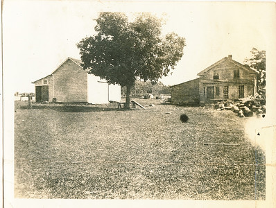 """Original house on the Rogers farm when they purchased it in 1864""  Side view of house in photo 6."