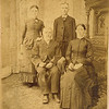 Edwin Dew (June 20, 1831 - March 27, 1910) son of Thomas Dew and Mary Ambury and his wife Percilla Adeline Rogers (July 2, 1844 - July 28, 1923) daughter of Joseph Rogers and Hannah Clark (seated) and their children Minnie Alice Dew (February 9, 1867) and William Alfred Dew (March 29, 1869 - June 12, 1965) (standing)