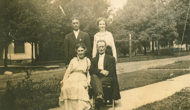 "Seated Ruey Jerusha Rogers (1850-1933) and her husband Jacob P. Shaver (1848-1919) and standing their children Orlo Harry Shaver (1873 - 1958) and Edna Mae Shaver (1877-1956).  Edna married Charles Emery Parker on November 23, 1898. Written in the Rogers Reunion Photo Album Volume 1 page 35 ""Orlo & Edna and Ruey & Jacob"""