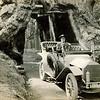 Gilbert Plummer Rogers (1846-1925) driving through a redwood in California.