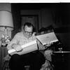 1964-12, John Askew Grimacing Opening Christmas Gift