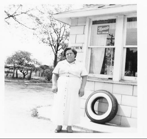 Evelyn Sanders in front of their store on highway 40 (the National Road) in Brazil, Indiana.