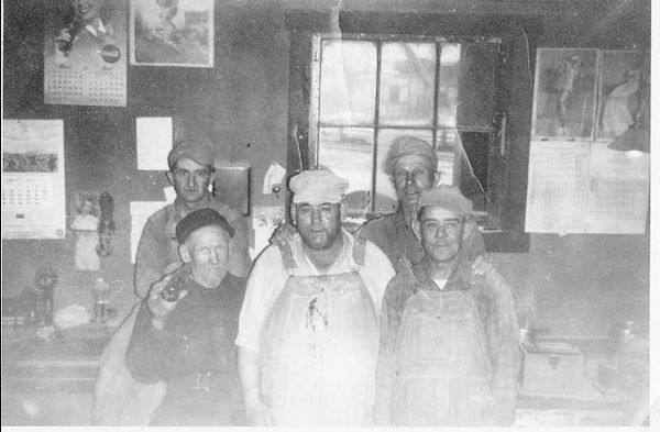 Roy Rhodes in Center with fellow workers at Graham Grain Co in Terre Haute.