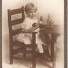 Unknown child at table with toy