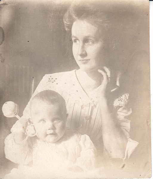 Pensive mother with baby - unknown