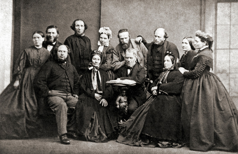 THe McLennan Family in Glasgow in the 1860s: identified are, back row, left to right, William with dark hair and beard, and to his left and balding, James Bowman, William's brother-in-law and at one time his business partner, and at the end in profile, James Bowman's wife and William's sister.<br /> Seated in the front row, behind the table, Donald McLennan, Kenneth's younger brother, and to his left, possibly Janet McLennan, Kenneth and Donald's sister.<br /> <br /> The rest are certainly all either William's sisters and spouses, or perhaps Donald's children. Sadly we will never know.