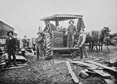 Taken on Cherry Hill Farm, Augusta County, Virginia between 1912-1916   The men are using Peerless steam traction engine, manufactured by the Geiser Manufacturing Company of Waynesboro, PA to saw raw timber .   Left to Right:  William Ken Smith, Edgar Stover,  Gene Stover, Dave Sheets, Leonard Arey, and Homer Cupp