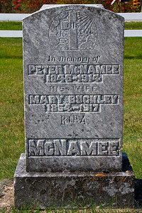 In memory of Peter McNamee 1846 - 1914 his wife Mary Buckley 1854 - 1917 R.I.P. A. McNamee