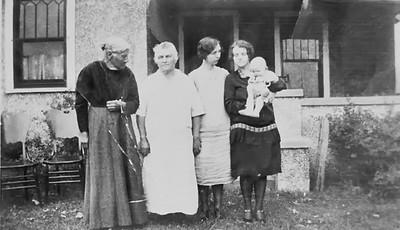 Frances (Eich) Schmitz, Louisa (Schmitz) Stein, Alma (Stein) Beckett, Easter Helen (Greathouse) Stein holding Mary Louise (Stein) Nehring Circa 1923