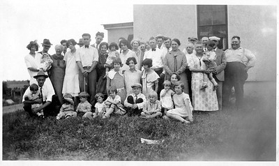 Presumed Schmitz Family gathering. Date unknown. Louisa on right with child, John Stein behind her with hat.