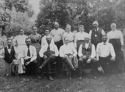 Presumed Stein/Schmitz; Family portrait. John and Louisa are 3rd from left back row. Date unknown. The tall man to the R of Louisa is Fred Kolancik and to his R his wife Mary (Schmitz).