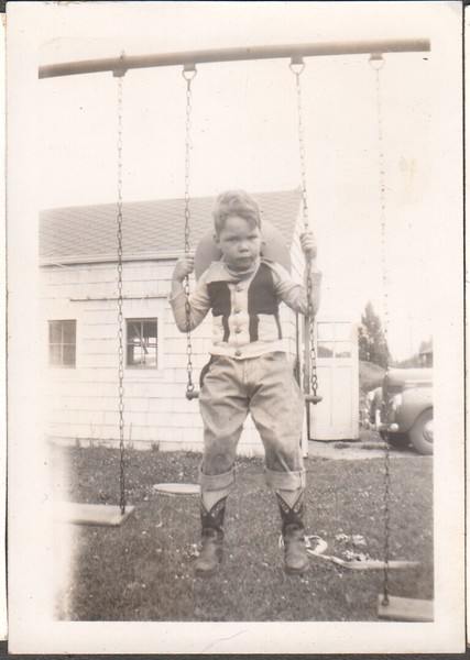Jim Stewart on swing in his cowboy outfit, 1948.