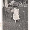Jim Stewart with Mary Stewart, Minneapolis back yard, 1948.
