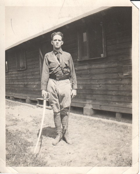Don Stewart as young man, posing in military uniform