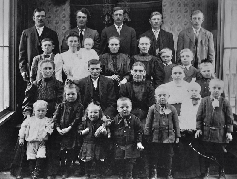 Allison Wysocki has provided this wonderful family photograph.  <br /> <br /> Shown are three generations of the Ehrhardt family from Unterdorf and was taken in early 1912 in Calgary.  George Ehrhardt was born in Holstein in 1860 and his wife Charlotte Schneider was born in Rosenberg in 1858.  Their first daughter Pauline was born in Holstein in 1882, but the rest of their children were born in Unterdorf, which was where they lived from the mid-1880s until they immigrated to Canada in 1906.  11 of the 24 people in the photo were born in Unterdorf, 4 were born in Holstein, one was born in Oberdorf, one was born in Rosenberg and 7 were born in the US or Canada.<br /> <br /> Back row:  David Kell (husband of Mary Ehrhardt, born in Holstein 1883); George Martin (husband of Anna Ehrhardt; born in Oberdorf); David Knaus (my great grandfather, husband of Amalia Ehrhardt, born in Holstein 1882); Peter Keller (husband of Pauline Ehrhardt, born in Unterdorf); Alex Ehrhardt (son of George & Charlotte)<br /> <br /> Third row: David Ehrhardt (son of George & Charlotte; born in Unterdorf 1902); Anna Ehrhardt (daughter of George & Charlotte; born in Unterdorf 1892); Rose Martin (infant daughter of Anna & George Martin, born in Colorado 1911); Amalia Ehrhardt (my great grandmother, daughter of George & Charlotte, born in Unterdorf 1887); Pauline Ehrhardt (daughter of George & Charlotte, born in Holstein 1882); Alex Keller (son of Pauline & Peter, born in Unterdorf 1905); David Keller (son of Pauline & Peter, born in Unterdorf 1901); Amalia Keller (daughter of Pauline & Peter, born in Unterdorf 1903)<br /> <br /> Second row (seated):  Mary Ehrhardt (daughter of George & Charlotte, born in Unterdorf 1890); George Ehrhardt (my 2x great grandfather, born in Holstein 1860); Charlotte Schneider (my 2x great grandmother, wife of George, born in Rosenberg 1858); Mary Aab (wife of Alex Ehrhardt, born in Unterdorf 1887); Johnny Ehrhardt (on Mary's lap, son of Alex & Mary, born in Calgary 1911)<br /> <br /> First row: David Kell Jr. (son of David & Mary, born in Calgary 1910); Mary Knaus (daughter of David & Amalia, born in WInnipeg 1907); Molly Knaus (daughter of David & Amalia, born in Colorado 1909); Jake Ehrhardt (son of Alex & Mary, born in Colorado 1909); Hank Ehrhardt (son of Alex & Mary; born in Colorado 1908); Alex Ehrhardt (son of Alex & Mary, born in Unterdorf 1906)