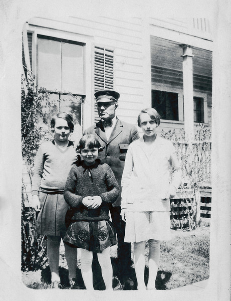 Vivian Nolin (on right), with (from left) sisters Erline and Rita, and Father Arthur in chaffeur uniform and hat, June 1931