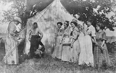 Church Revival Tent circa 1909 Seaton, IL.; Clarence Werts kneeling and Nellie left with camera.