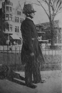 Officer Jim Shea 1917 in front of the Fountain & Rood Building in Evanston, IL. He was Nellie Werts' boyfriend and was killed in an arrest attempt on Davis Ave. in Evanston Feb. 25, 1918.