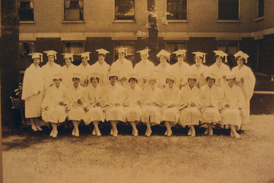 Catherine Werts as Nursing School Graduate (1st left front row)