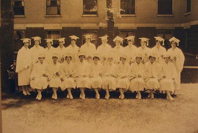 Catherine Werts as Nursing School Graduate (1st left front row)