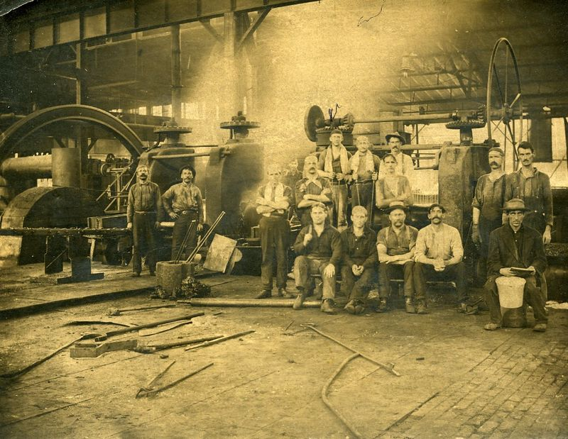 Edward Wintersole at work Sept 1907<br /> Tall man in back with towl on neck (left)