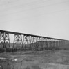 "<center>Note from Ranee Gienger: ""The bridge across the river could be between Bismarck and Mandan.   We don't have a bridge like that anymore --- but we could find out if something like that was there. Note from Glenn Griffin: ""High Bridge U.C."" as noted with negative. Photo by Alvin Halvor Larson, restored by his grandson, Glenn David Griffin."