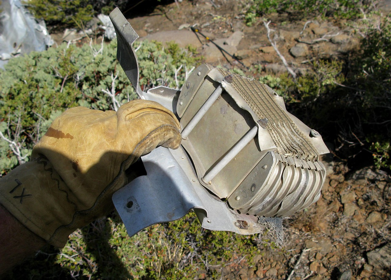 The aircraft engine oil cooler was among a few engine components scattered around the main impact site.